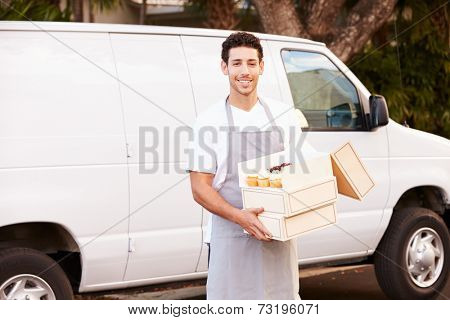Baker Delivering Cakes Standing In Front Of Van