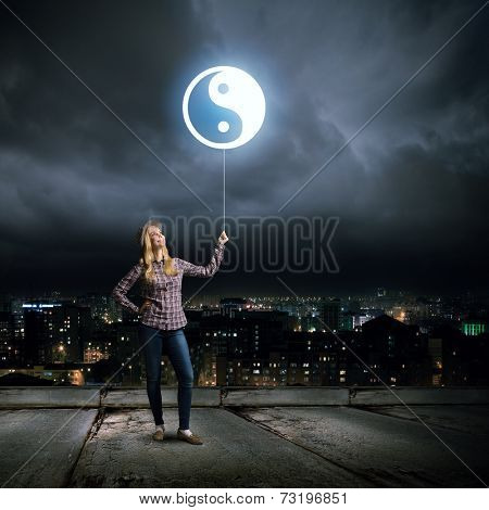 Young girl in casual and yin yang sign
