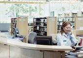 picture of librarian  - Librarian talking on phone - JPG