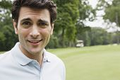 picture of cynicism  - Close up portrait of man on golf course - JPG