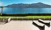 pic of penthouse  - beautiful terrace of a penthouse overlooking the lake - JPG