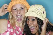 stock photo of chums  - Two young women laughing - JPG