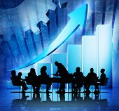 stock photo of economics  - Group of Business People Meeting on Economic Recovery - JPG