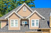 stock photo of nice house  - the roof of the house with nice window - JPG
