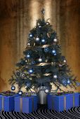 foto of christmas theme  - 3D Rendering of Beautiful blue themed Christmas tree decorated with blue baubles and ornaments and a silver ribbon garland with blue giftwrapped presents below to celebrate the festive season - JPG