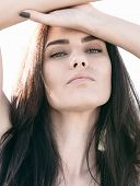 stock photo of raised-eyebrow  - Attractive alluring young woman with a seductive expression - JPG