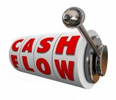 image of cash  - Cash Flow words on slot machine wheels or dials as money or income earned for your budget or finances - JPG