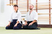picture of aikido  - Man and woman at Aikido training in martial arts school  - JPG