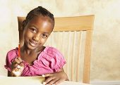 image of coy  - Young African girl holding pencil and smiling - JPG