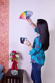 Girl Choosing A Color For The Walls