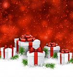image of  realistic  - Abstract christmas background with fir branches and realistic gift boxes - JPG