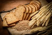 pic of whole-wheat  - fresh bread and wheat on the wooden - JPG