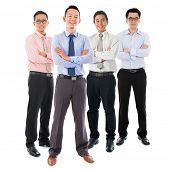image of southeast asian  - Portrait of group Southeast Asian businessmen standing isolated on white background - JPG
