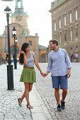stock photo of royal palace  - Stockholm couple walking romantic by Royal Palace - JPG