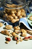 foto of nutcracker  - Peanuts and nutcracker on plate - JPG
