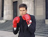pic of boxing day  - Businessman wearing boxing gloves - JPG