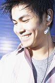 picture of pacific islander ethnicity  - Close up of Pacific Islander man wearing hands free device - JPG