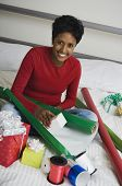 picture of east-indian  - Indian woman wrapping gifts on floor - JPG