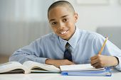 stock photo of pre-adolescents  - Portrait of African boy studying - JPG