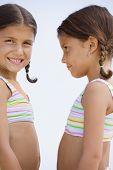 image of chums  - Hispanic sisters wearing matching bathing suits - JPG