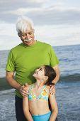 foto of granddaughters  - Hispanic grandfather and granddaughter at beach - JPG