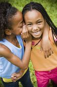 stock photo of pre-adolescent girl  - Portrait of African girls telling secret - JPG