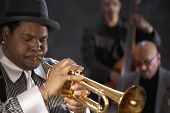 pic of trumpets  - African man playing trumpet - JPG