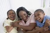 image of pre-adolescent child  - African American mother and children laughing - JPG