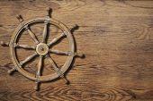 picture of ship steering wheel  - Steering wheel over wood background wall - JPG