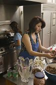 picture of chums  - Hispanic women preparing food - JPG