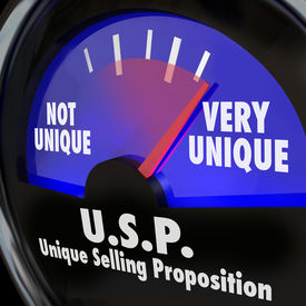 stock photo of uniqueness  - USP Unique Selling Proposition words on a guage or measurement tool measuring your level of special or different skills and abilities - JPG