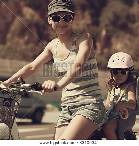Smiling Woman And Kid Riding In Sun Glasses. Vintage Closeup Portrait