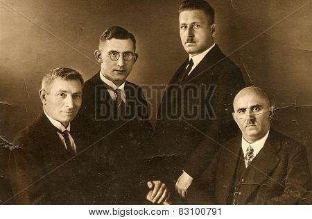 BERLIN, GERMANY, CIRCA 1930's: Vintage photo of four elegant men