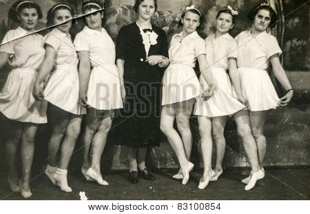 BERLIN, GERMANY, CIRCA 1930's: Vintage photo of young ballet students with their teacher