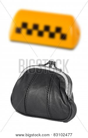 Taxi Sign And A Leather Purse