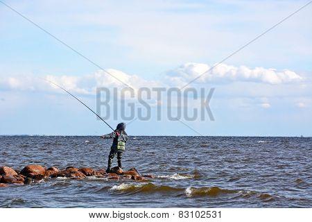 Fisherman At The Sea