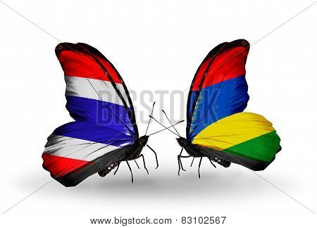 Two Butterflies With Flags On Wings As Symbol Of Relations Thailand And Mauritius