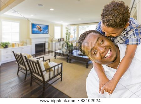 Playful African American Father and Mixed Race Son in Living Room of House.
