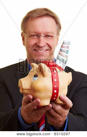 Manager With Money And Piggy Bank