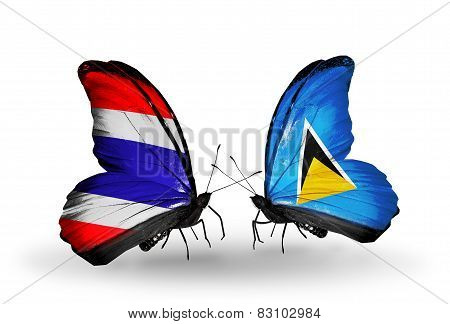 Two Butterflies With Flags On Wings As Symbol Of Relations Thailand And Saint Lucia