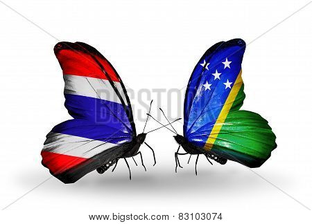 Two Butterflies With Flags On Wings As Symbol Of Relations Thailand And Solomon Islands
