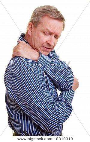 Man Touching His Aching Shoulder