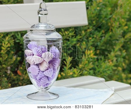 Marshmallow in a glass bowl on vivid background