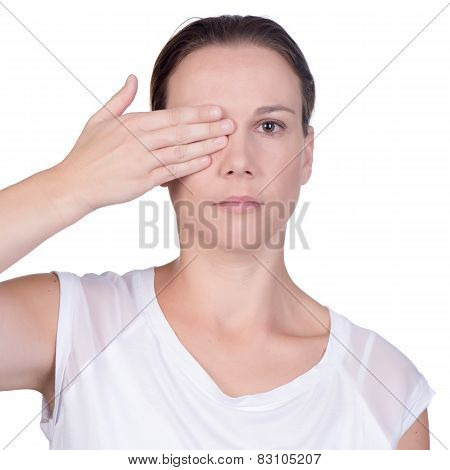 Woman With Hand Over One Eye