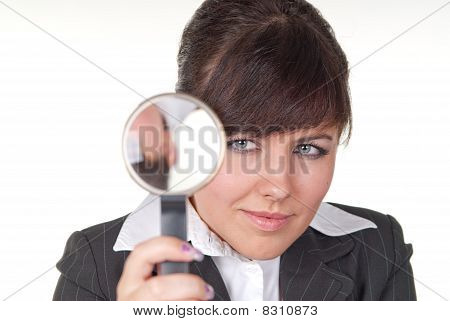 Young businesswoman with Loupe