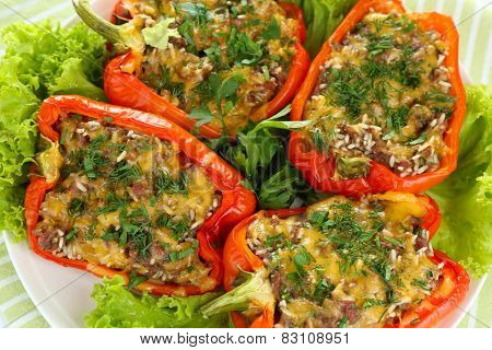 Stuffed red peppers on plate on napkin close up