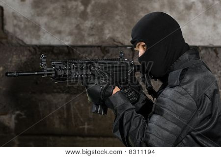Armed Man With Automatic M-4 Rifle