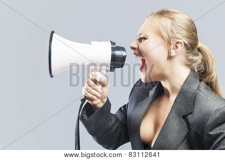 Sexy Furious Caucasian Blond Female In Lingerie And Suite Shouting Using Megaphone. Against Gray Bac