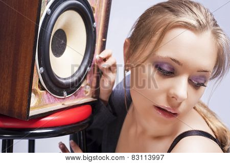 Sensual Caucasian Blond Woman Listening To Loudspeaker