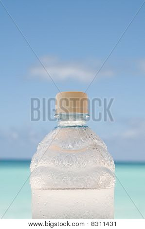 Cold Bottle Of Water On Beach